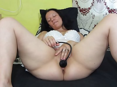 Chubby mummy frigging hairy pussy, with inflatable faux-cock spreading and fucking vagina, licks her orgasm juices. Home onanism and wide open cunt.