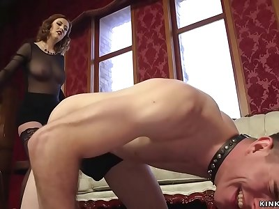 Buxomy mistress pegging roped man