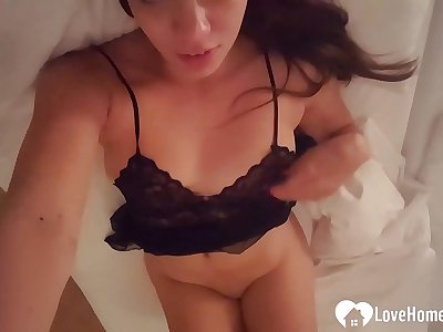 Black-haired stepsister records herself in her sofa