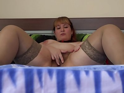 A beautiful BBW wiggles her sweet PAWG and makes herself deep vaginal fisting. A homemade fetish of fat hairy beaver and widely opened cunt.