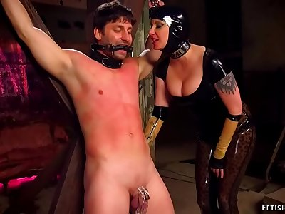 Domme in spandex and gimp torments sub