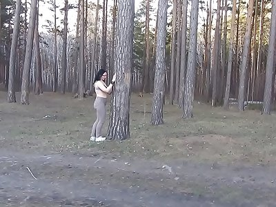 A mummy with big tits and a delicious PAWG peels off in the forest and masturbates her cunt with a spruce branch. Merging with the nature of a mature nudist. Outdoor unexperienced fetish.