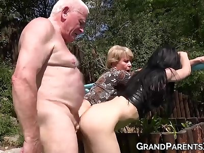 Blonde granny and youthful honey outdoor hard fucked by grandpa