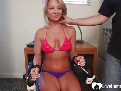 Sexy blonde gets kittled while tied up