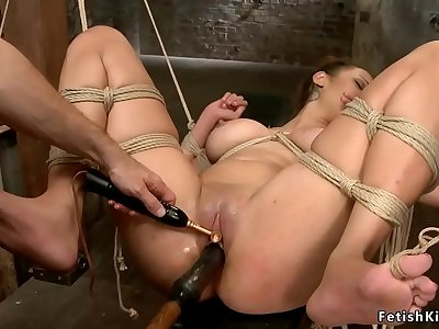 Big tits suntanned victim on hog-tie